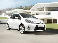 TOYOTA YARIS HYBRID IN WHITE 2013 MODEL, COMES IN BLACK TOO.....:)