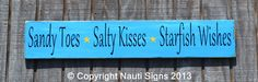 Original Beach Décor Sign perfect for your Beach House, room or a great gift   for a beach lover!  This would also make a great sign for Beach Weddings!  Sandy Toes - Salty Kisses - Starfish Wishes  Hand painted rustic wood sign in aqua blue, teal and a light seaglass green mixed  with black lettering.  Size is:  34x6  This is a very sturdy thick wood sign.   It has been distressed   to give it that rustic flair. We then seal it with a coat of poly to protect it   for years to come.   We ...
