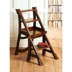 This is a library chair - a chair that flips into a set of stairs to reach the books at the top of your bookcase. If I were a rich girl...