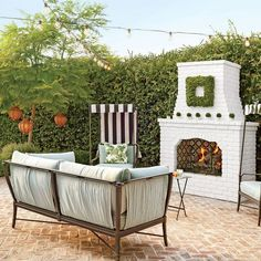 herringbone brick with white painted fireplace: House of Turquoise: Waterleaf Interiors Architectural Landscape Design Outdoor Seating Areas, Outdoor Rooms, Outdoor Living, Outdoor Furniture Sets, Indoor Outdoor, Outdoor Decor, Outdoor Planters, Outdoor Fireplace Designs, Backyard Fireplace