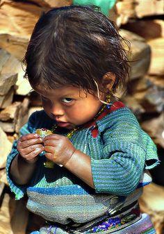 Small child in Guatemala by Sergio Pessolano
