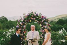 Lovely floral wedding arch, from 'A 1960's Inspired Gown And Pretty Flower Crown For A Home Garden, Vintage Style Wedding' on www.lovemydress.net.  Photography by http://www.kitchenerphotography.co.uk/