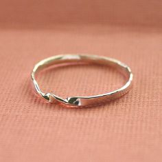 Twisted Ring thin skinny forged sterling silver wire band. $14.00, via Etsy.