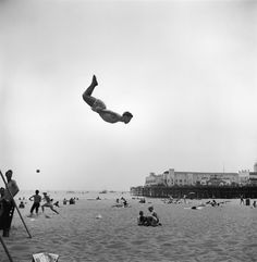Daring young man flies off trampoline at California's Santa Monica Beach, where movie starlets show off. (Loomis Dean—The LIFE Picture Collection/Getty Images)