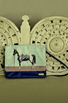 """Blue Horse Print Sling Bag - Sporting a unique horse print, this structured sling bag is highly fashionable. Flap closure with a brand tab towards the bottom. Comes with a shoulder sling.  Colour:  Blue, Multi.  Material:  PU Leather.  Dimensions:  12.5"""" x 2.25"""" x 10"""".  Estimated delivery within 7 - 14 days after ordering."""
