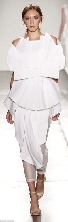 Crisp whites: White and silver garments were also shown, two of them featuring an overwhel...
