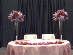 Stunning sweatheart table with lush purple arrangements.    www.helenolivia.com