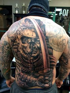 Back tattoo, in progress by Carl Grace. Badass.