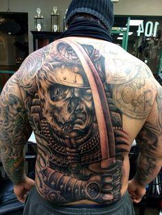Back tattoo, in progress by Carl Grace. Badass.