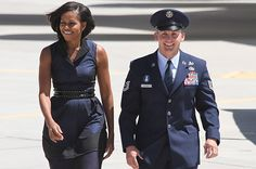 Dressed in a navy frock, the First Lady arrived in Albuquerque, N.M. for a four-state campaign tour on May 1, 2012.