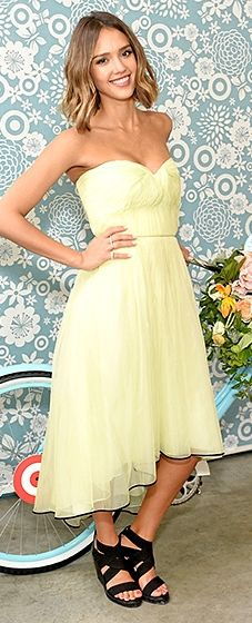 The baby product company co-founder was spring-ready in a lime Monique Lhuillier sweetheart dress with black piping around the hemline.