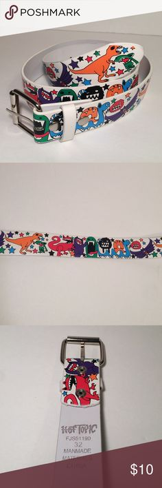 Hot Topic Belt This white belt is awesome and is in great condition. The belt features fun dinosaurs, bats, and monsters in bright colors hat pop against the white base. This belt has silver hardware. Size 32. Hot Topic Accessories Belts