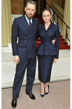 Stella McCartney in a bespoke navy suit to collect her OBE at Buckingham Palace