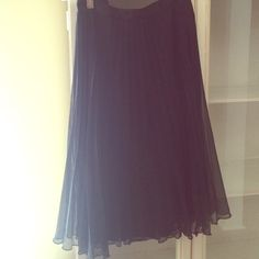 """Black Pleated Vintage Skirt Black pleated, classy, vintage skirt for a night out or even for work. Fitted silk waist band, sheer overlaying skirt, hidden side zipper. Approximately 23 1/2"""" in length. Skirts A-Line or Full"""