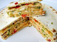la torta di piadina con una farcia di verdure e formaggio!troppo buona perfetta come piatto unico o per un antipasto !!La cucina di ASI