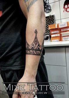 Crown bracelet tattoo
