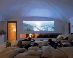 Such a relaxed way to enjoy a movie with the comfort of staying at home. What I like in this space, is that it's not a dark cave. Beautiful light walls and i like the vaulted ceiling.