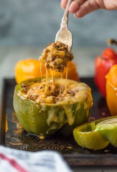 ThisSTUFFED PEPPERS RECIPEis our go-to easy dinner recipe. These Cheesy Enchilada Stuffed Peppers are loaded with beef, green chiles, onions, enchilada sauce, and so much cheese! You won't believe how easy these are and how much your entire family will love them.