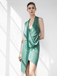 Helmut Lang dress in green cupro jersey with asymmetrical-draped top & handkerchief hem. Also available in black. 212 872 2843