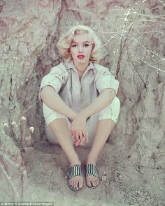 Taken in 1953 in LA, Marilyn dons a white shirt, capri trousers and striped sandals for 'T...