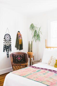 Black Medium Dreamcatcher (Raven) adding texture to this desert boho bedroom