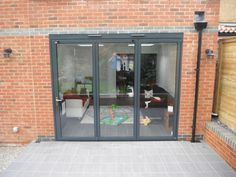 A 3 leaf aluminium bi fold door in mouse grey ral 7005 doors and solarlux 3 panel system in anthracite grey planetlyrics Choice Image