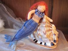 A mermaid with an embroidered tail.