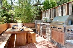 Rustic reclaimed wood kitchen table and bench on contemporary patio