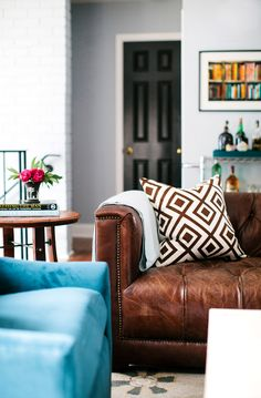 Leather sofa with brown and white patterned pillow