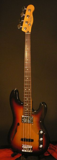 Fender Japan mid 2000s thinline Precision bass with telecaster headstock in sunburst