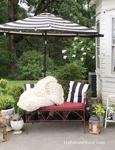 How to Add Fringe to a Outdoor Umbrella #outdoorumbrella #diy #fringe #crafty #diyumbrella #fringeumbrella #blackandwhite #stripeumbrella #redoutdoor #outdoor #patio #gardenspace #gardendecor #redbench #hallstromhome #diy #tutorial