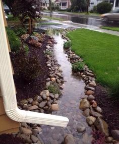 Homes. Lawn. River rocks. Landscaping rocks. Creative way to have the rain run off/ drain from downspout.