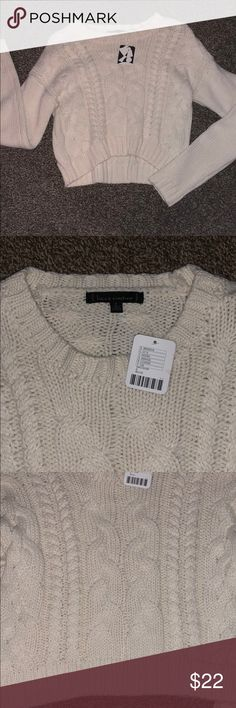 Cropped sweater Never been worn. Cream colored. Cropped, I had the idea to wear it with a high waisted skirt but never found one I thought would look cute with it. Very thick sweater material Sweaters Crew & Scoop Necks