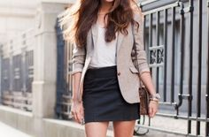 Light brown jacket matching with black skirt