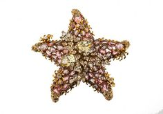 An Iradj Moini star brooch, set with multicolor stones. : Lot 1279