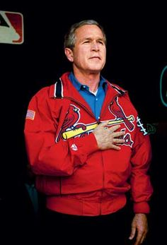Standing for the national anthem President Bush before the Major League Baseball season opener at Busch Stadium in St. Louis, MO, April 5