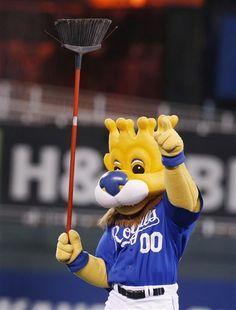 Kansas City Royals mascot Sluggerrr celebrates following the Royals' baseball game against the Minnesota Twins at Kauffman Stadium in Kansas City, Mo., Wednesday, April 10, 2013. The Royals defeated the Twins 3-0 to sweep the three-game series. (AP Photo/Orlin Wagner)