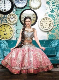 Pink meets grey for a modern spin on a traditional lengha. Divine.