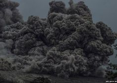 This picture taken on June 13, 2015 shows a close-up of volcanic ash flowing down from Mount Sinabung in Karo
