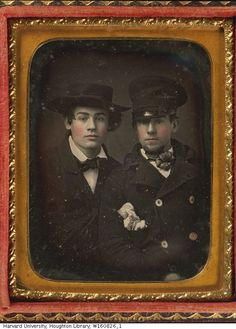 """Two men wearing hats. Date: 1855. Creator: Tyler, Edward M. & Co. (n.d.), United States, photographer.Hand Colored / Case cover material: leather. Identifying Marks: Printed card on back of image: """"Keep other side clean/ by rubbing it with a rag or a piece/ of chamois skin/ Taken with the/ Double Camera for 25 cents, by Tyler and Co.,/ Cor. of Winter & Wash Sts./ Boston./ 600 Daily. Beware/ of Imitation."""""""