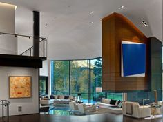 Cozy Living Room Design At Aspen Art House Near Contemporary Fireplace Along With Furniture Applied Cream Sofa As Well As Chairs