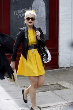 Bright dress with matching bow in hair, and jacket with matching belt