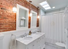 Image result for exposed brick bathroom