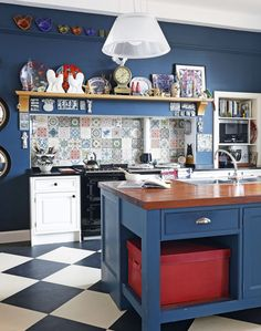 Blue-painted Kitchen with Patterned Tiles and Splashback