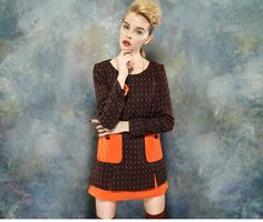 http://www.thefishbag.com/h/Clothing/Dress/p1373.php The dress featuring overall orange Polka Dot detail,Round necklineLong sleeve, Orange patch pocket embellishment,Tiered contrast color Hem,slit hem .