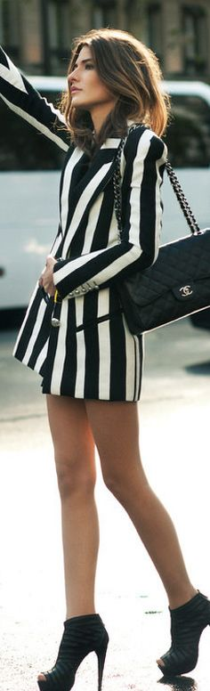 Street Style - Black and white striped blazer paired with leather booties and a Chanel handbag! If you like my pins, please follow me and subscribe to my fashion channel on youtube! It's free! Let me help u find all the things that u love from Pinterest! https://www.youtube.com/channel/UCCP8TXebOqQ_n_ouQfAfuXw