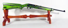 "Ruger 10/22 Lime Green & Black .22LR 18.5"" *NIB* Catalog # 10/22RBLZBBZ, Model 1232. The Ruger 10/22 rifle is America's favorite 22 LR rifle, with proven performance in a wide range of styles for every rimfire application. Ideally suited for informal target shooting, ""plinking,"" small game hunting and action-shooting events, Ruger has sold millions of 10/22 rifles since their introduction in 1964. Features 10-round rotary magazine, alloy steel frame. 5.25 lbs. $339.99"