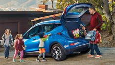 Ethan Stock with his wife and two kids loading things into the back of their blue 2017 Chevy Bolt EV. Chevrolet Volt, Chevy, Manual Transmission, Automatic Transmission, Performance Exhaust, Android Auto, Rear Seat, Cadillac, Kids