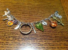 12 charms Lord of the Rings - inspired charm bracelet - BRACELET WITH 12 CHARMS - Gondor, Sauron, Leaf of Lorien