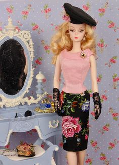 Fully lined, pencil skirt and blouse with attached rhinestone brooch. These separates were sewn entirely by hand from a vintage hand-embroidered petit point hankie and a blush pink linen hankie. Both pieces are lined in cotton and fastened with metal snaps. Fashion includes blouse, skirt, and hat only. This fashion is specially made to fit: - Silkstone Barbie - vintage Barbie - Victoire Roux - and similar size dolls Fashion does not include doll, jewelry, shoes, gloves, or objects in…